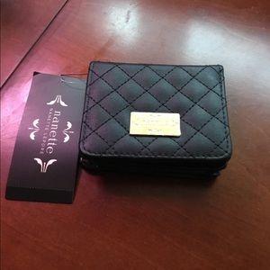 Nanette Lepore black and gold foldout wallet